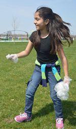 Jasmin Cruz hurries to clean up