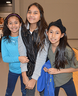 Wyoming Public Schools students Jennifer Cruz-Ochoa, Yahair Rangel and Annali Berales hang out during the Parkview Family Fun Night