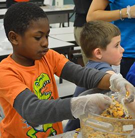 First-grader Matthew Willison-Beedon packs a baggie
