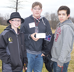 Eighth-graders David Marsh, Nathan Lemons and Chandon Reed get in some geocaching during the Kent ISD-sponsored alternative spring break