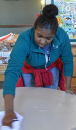 Crossroads student Brakezia Sylvester cleans a table