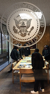 Students in Amy Holubeck's eighth-grade class at Gerald R. Ford Academic Center examine presidential documents at the Gerald R. Ford Presidential Library in Ann Arbor