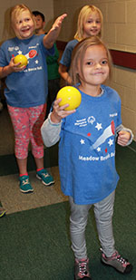 Natalie Norman gets encouragement from fellow students as she prepares to take her turn at bocce ball