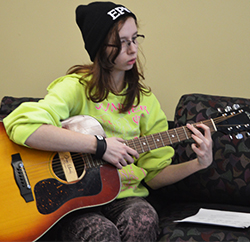 Senior Marissa Minier practices playing the guitar