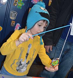 """Vincent Schmuker, 4, catches an """"M"""" fish"""