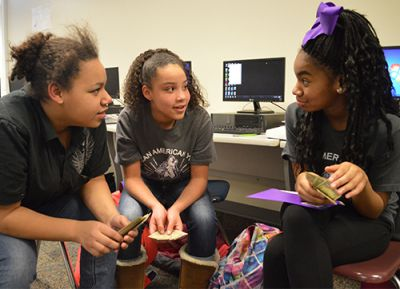 Seventh-graders Tajanna Price, Morgan Lamar and Shia Jenkins chat