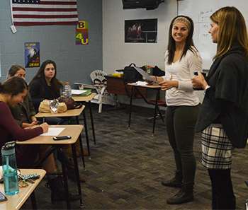 Counselor Sarah Young, right, and Mackenzie Vallad lead a recent meeting of the Developing Healthy Kids Student Board
