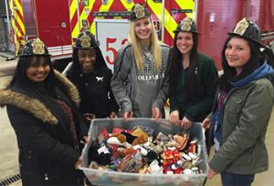 The girls donated stuffed animals for firefighters to give to children