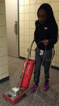 A student cleans the Kentwood Fire Station, where one group donated time