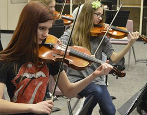 Corrina Wenger (left) and Chloe Looman hone their violin parts