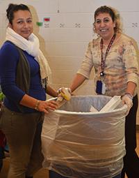 Yolanda Guzman and her friend Jeidi Guzman-Celaya work in the cafeteria