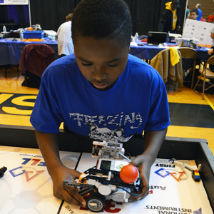 Love Kellogg prepares the team's robot for competition