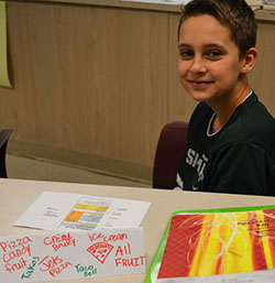 Sixth-grade student Jaden Campbell studies nutrition labels