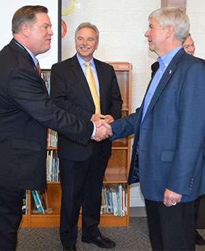 Gov. Rick Snyder shakes hands with Kentwood Public Schools Superintendent Michael Zoerhoff