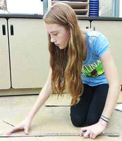 Eighth grader Anna Pavlak is one of many award-winning art students Campbell has taught