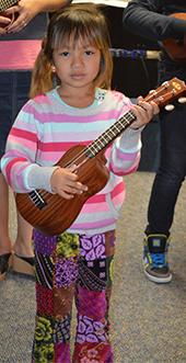 Newcomer Program student Paw Hyser Gay plays the ukulele