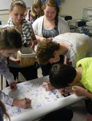 Students line up to sign the Be Nice banner in support of the Be Nice pledge
