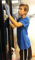 Aidan Dunfee, 11, cleans lockers