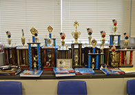 """We the People"" trophies line the wall in Janice Yates' classroom"