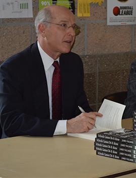 Jamie Vollmer signing copies of his book