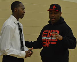 Eric Thomas chats with senior Thomas Robinson
