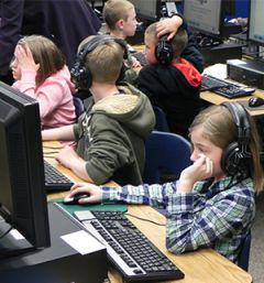 Appleview Elementary's Karley Miller (front) and fellow classmates used headphones to reduce outside noise while concentrating on the Interim Assessment pilot test
