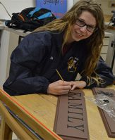 East Grand Rapids High School senior Alicia Dills works in Advanced Art class