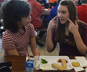 Maggie Maring has helped Jocelyn Noviskey learn sign language