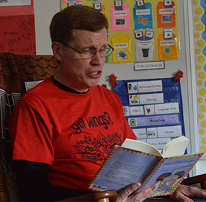 Kent City Elementary School kindergarten teacher reads to his students