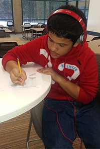Freshman John Salgado works on algebra homework