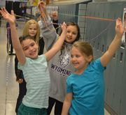 Students hold up their creation
