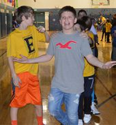 Fifth-grade student Levi Neuhaus leads the Conga line
