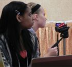 Sparta High School students Tateanna Muhqueed (left) and Angel Groth filmed and operated the slideshow for the presentation
