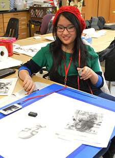 Club member junior Amanda Klassen works on a sketch. She has a piece that has advanced to the Michigan Art Education Association state competition for judging