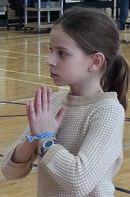 Fifth grader Kate Stevens practices yoga