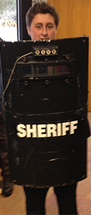 Jacob Dalton from Rockford shows off the riot shield
