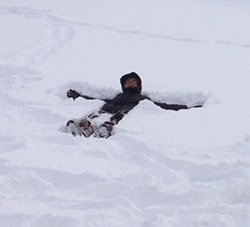 Kent Zhuang made a snow angel on his first day in a West Michigan snow