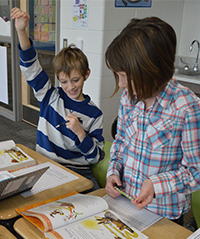 "Brown Elementary third-graders Jackson Bossenbroek and Avery Wilson consider the characters in ""The Tortoise and the Hare"""