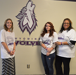 Wyoming Junior High teacher Angie Miller, eighth-grade student Sophia Rodriguez and social worker Brooke Davis wear their Team Easton shirts and bracelets