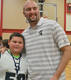 Valleywood Middle School seventh-grader Vincent Nelson meets former MSU basketball player Anthony Ianni