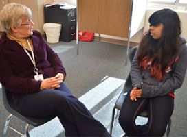 "Barb Berry chats with eighth-grade student Perla Vazquez-Juarez about her ""My Michigan Hero"" essay."