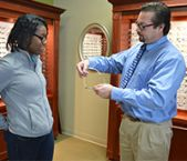 Dr. Troy LeBaron shows Sheliah Harris-Spencer frames