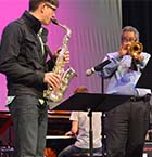 Faddis works on solos with Northview alto sax player Mason Biilo