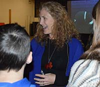 Goodman talks with North Rockford Middle School students after her presentation