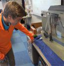 Student Cooper Bell checks out the fish, in their alevin stage