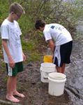 Students release salmon into the Rogue River