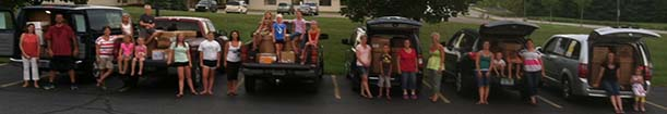 It takes many elves and cars to deliver all the supplies before school starts