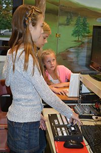 Working behind the scenes on the computers are, from left, Savannah LeRoux, Reagan Morse and Madalyn Higgins