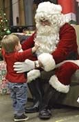 Santa has a heart-to-heart talk with Lleyton O'Rourke, 2