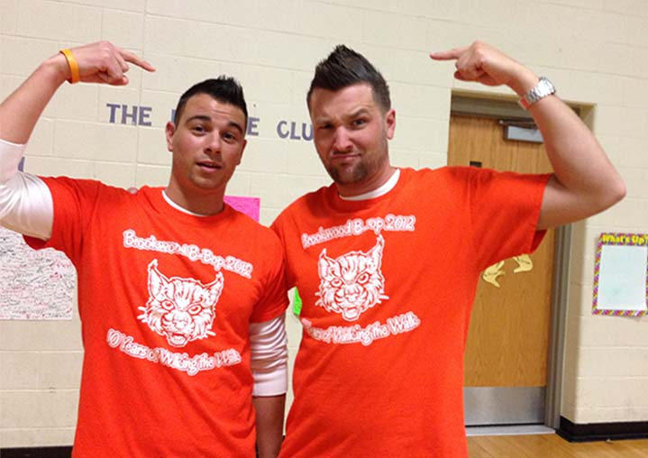 Teachers Nick Carlesso and Todd Jongekrijg show off their Mohawks after a celebration of students' improved tests scores